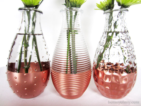 Copper dipped vases up close