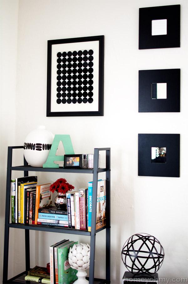 Graphic wall art above bookshelf
