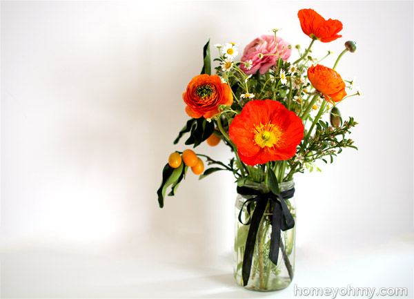 Ranunculus kumquats and poppies arrangement