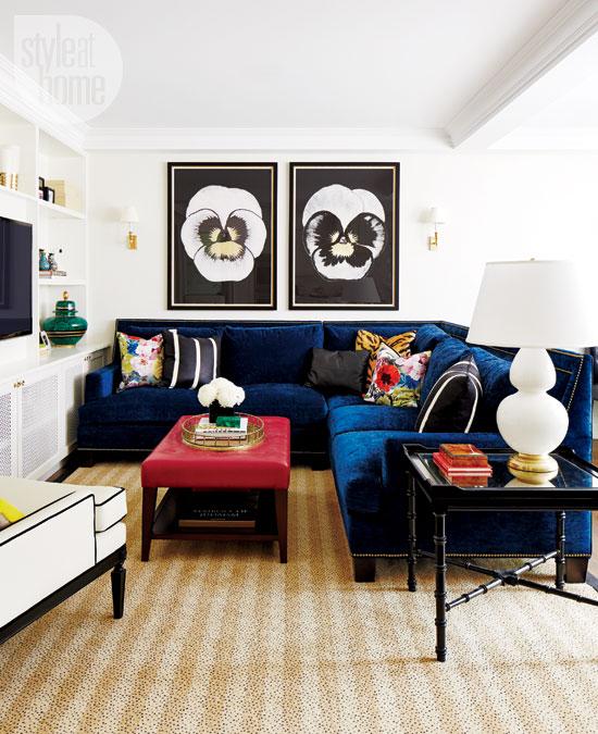 Blue velvet couch in chic living room