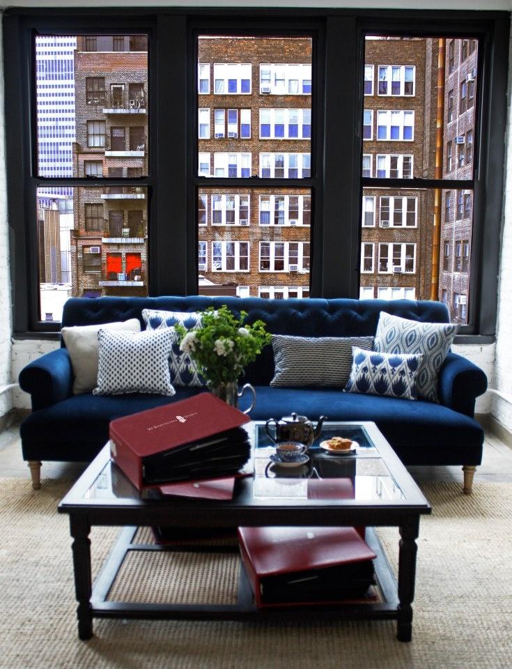 Blue velvet couch in studio