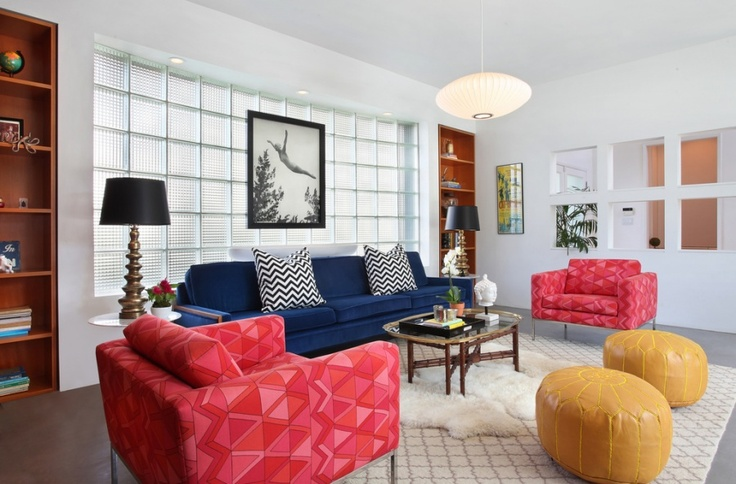 Colorful living room with blue velvet couch