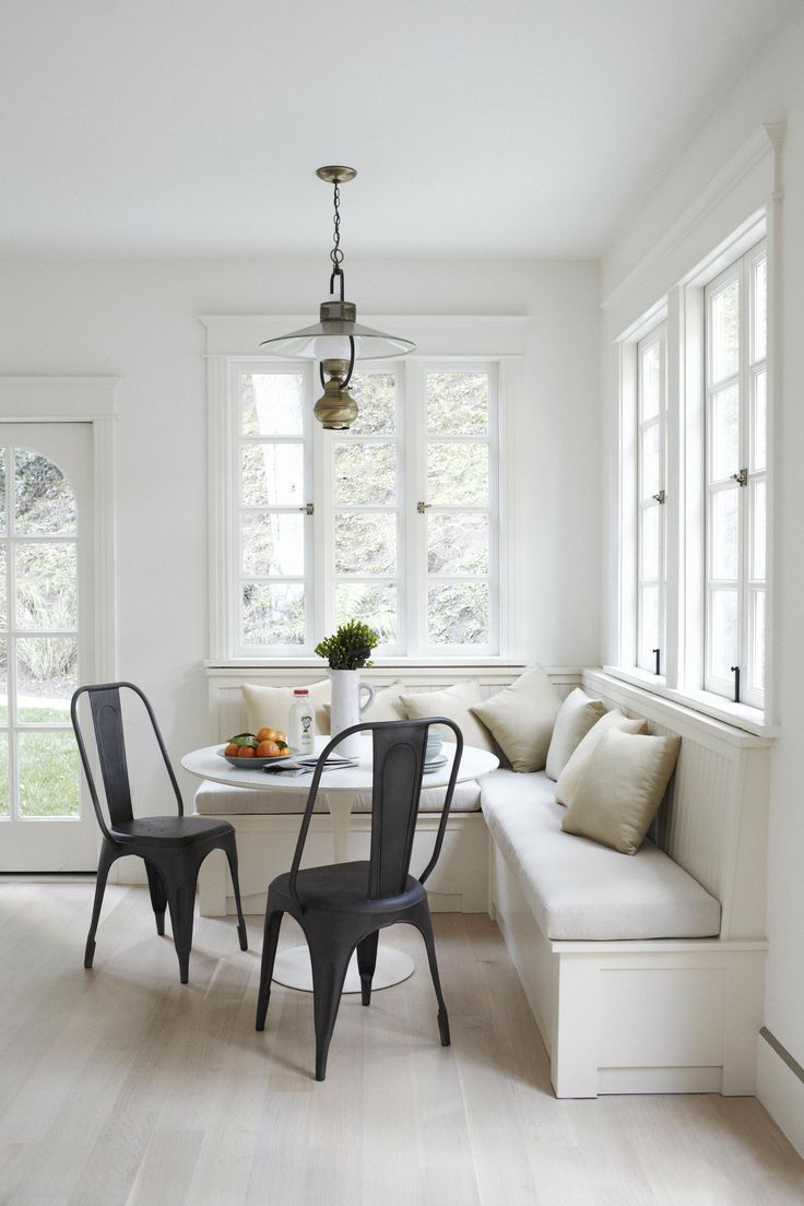Tulip table with banquette seating