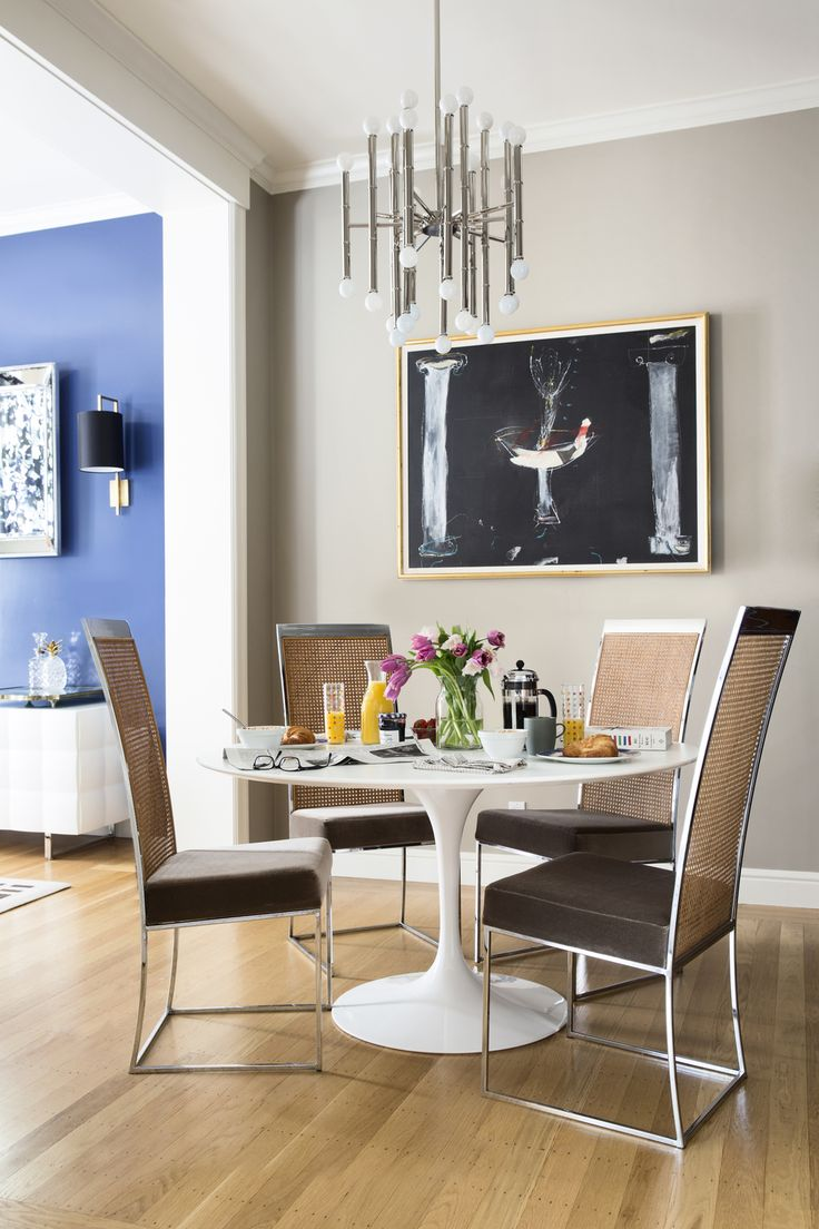 Glam dining room with tulip table