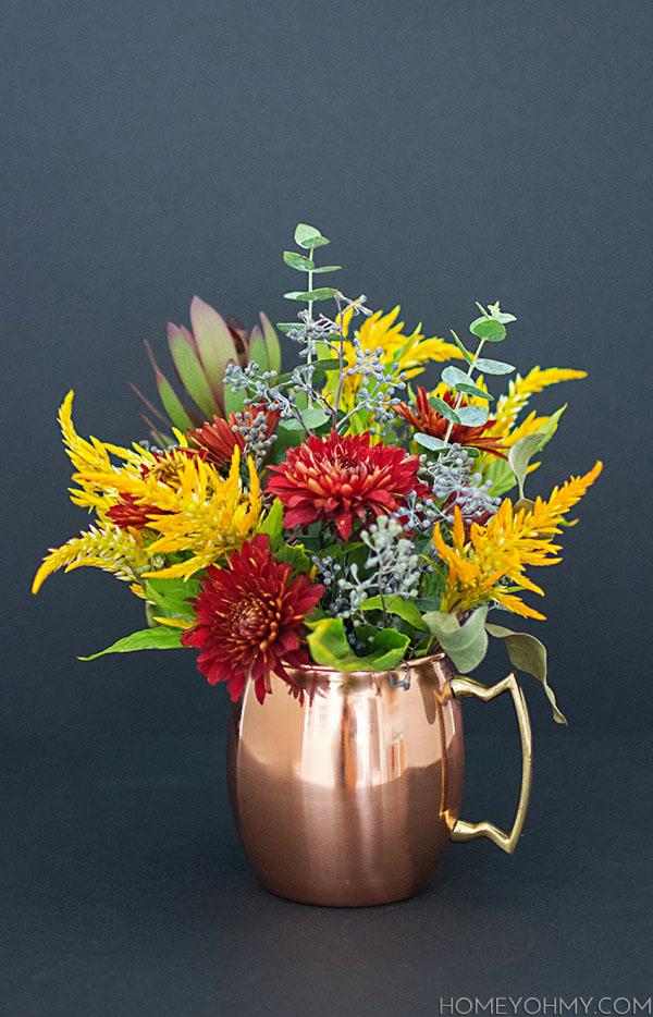 Fall flowers in a copper mug