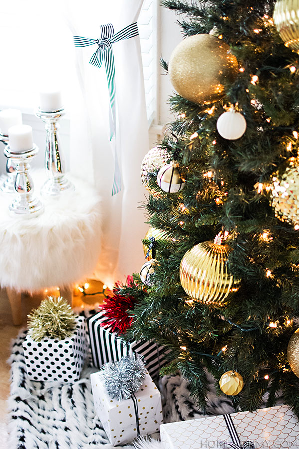 Christmas tree with gold ornaments.  Use a fur throw as a simple tree skirt!