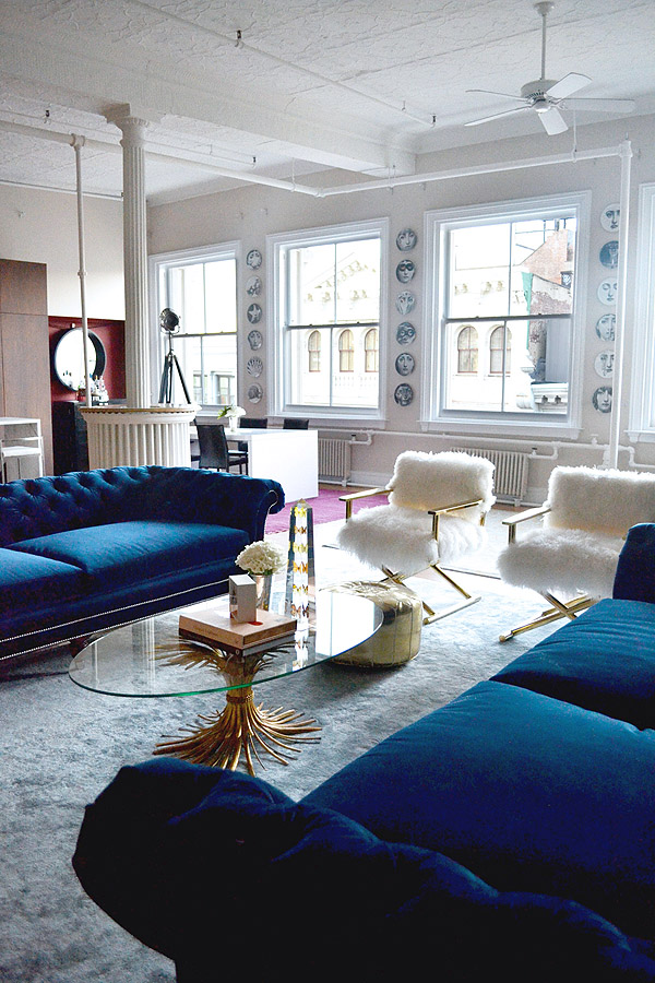 Soho-NYC-loft-Tamra-Sanford-living-room-fuzzy-chairs-blue-velvet-sofas-windows